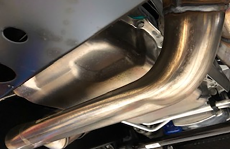 Exhaust Pipe Shaped to Avoid Low Contact